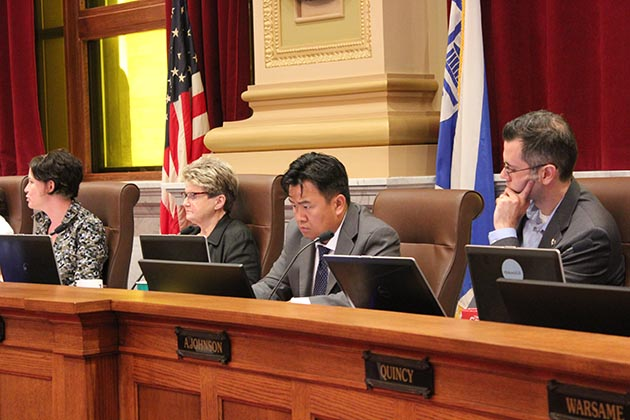 "Ward 5 City Council Member Blong Yang, second from right, cast the lone ""no"" vote on the ordinance. Photo by Dylan Thomas"