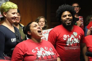 CTUL Executive Director Veronica Mendez Moore celebrated with other advocates for a $15 minimum wage. On Friday, the City Council passed an ordinance that will rise the minimum wage to $15 over a period of 5–7 years, depending on business size. Photo by Dylan Thomas