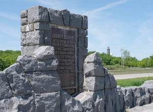 This roadside marker for Minnesota's first granite quarry is located across Highway 10 from the actual site because the quarry is on St. Cloud Correctional Facility's property. Photo by Linda Koutsky