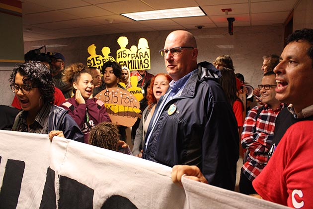 The third-floor hallway outside of council chambers was choked with hundreds of people just before a June 22 public hearing on the municipal minimum wage began. Photo by Dylan Thomas
