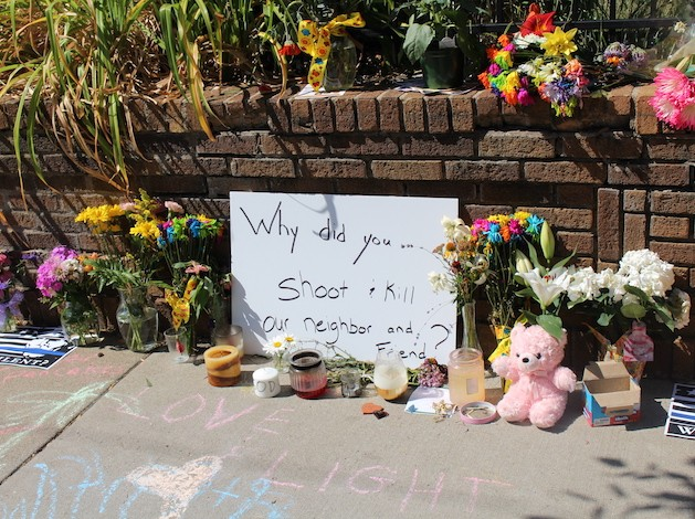 Memorials to Fulton resident Justine Ruszczyk lined the sidewalk Monday near the intersection of Washburn & 51st.