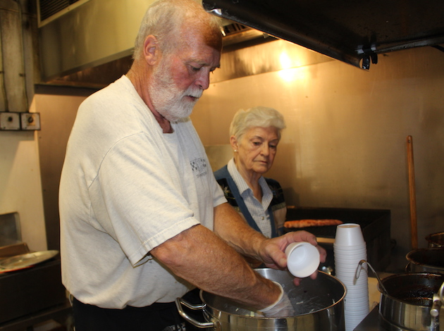 Scott Woolsey and his mom, Dorie Woolsey, prepare coleslaw on a recent morning.
