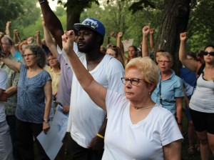 People rally against police killings of civilians Thursday, five days after the fatal shooting of Fulton resident Justine Ruszczyk by a Minneapolis police officer. Photos by Nate Gotlieb