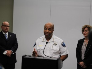Acting Police Chief Medaria Arradondo flanked by Mayor Betsy Hodges and Ward 11 City Council Member John Quincy.