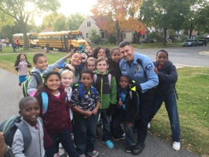 An SRO poses for a picture with students. Photo courtesy Minneapolis Police Department