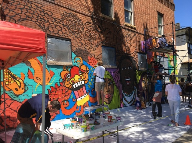 Volunteers paint Treehouse Records' new mural. Photo by Paul Shanafelt