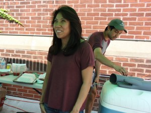 Bonita Kitchen owner Lenni Canell chats with a customer while her son Matt Graven cooks Filipino eggrolls.