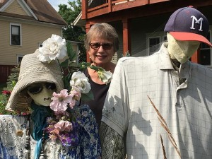 Barb Balcom and her scarecrows. Photo by Steve Brandt