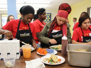 Minneapolis students plate a tamale dish Aug. 15 during a cooking seminar in Project SUCCESS' new student learning center. Photo by Nate Gotlieb