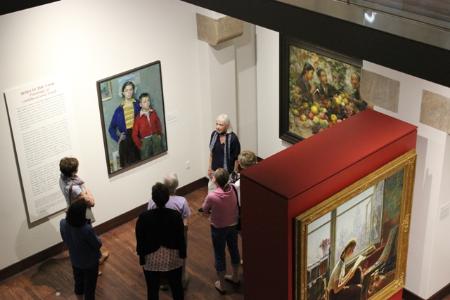A docent leads a tour at The Museum of Russian Art.