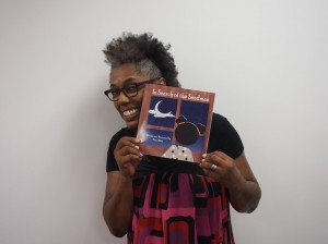 "Kenny resident Timi Bliss holds her children's book, ""In Search of the Sandman."" Submitted photo"