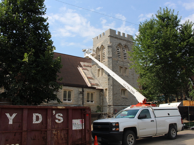 Repairs are underway on the bell tower at St. John's Episcopal Church at 42nd & Sheridan in Linden Hills. Members built the church about 100 years ago. Photo by Nate Gotlieb