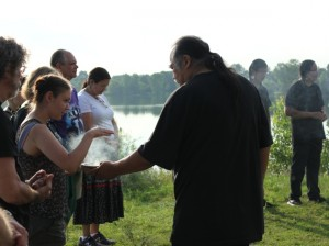 LeMoine LaPointe burns sage as part of the Four Sacred Directions Water Walk.