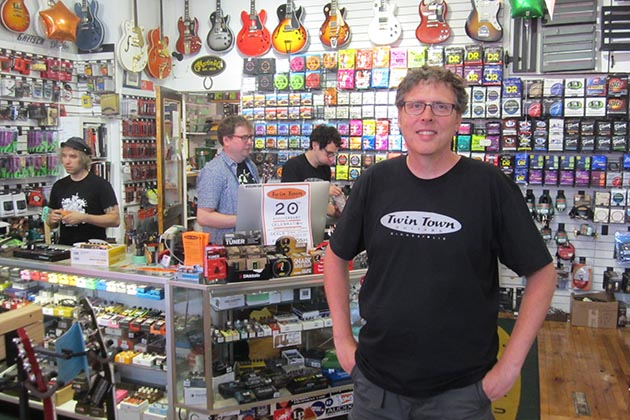 Twin Town Guitars owner Andrew Bell and crew were busy all day at an Aug. 5 party celebrating 20 years of music education and community on the corner of 34th & Lyndale. Photo by Jim Walsh
