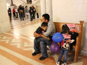 Eduardo Calero sits with his children at City Hall Sept. 18. Activists on a bus tour met with federal and local offices to defend the DACA program.
