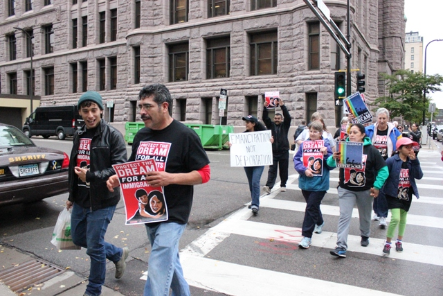 """Pablo Tapia of Asamblea de Derechos Civiles (center) and others participated in a day of action Sept. 18. The group visited congressional offices and City Hall to """"demand civil rights for dreamers and all undocumented immigrants,"""" ending the day with a sit-in at the Hennepin County Jail."""