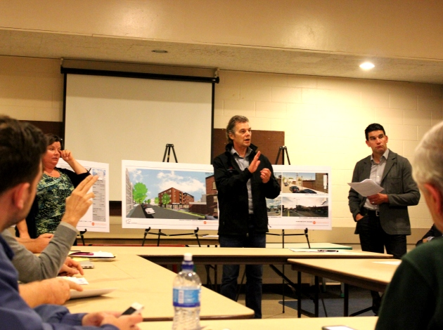 Developer Jim Graves (center) speaks to Lowry Hill residents Sept. 5.