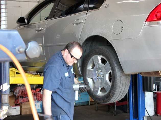John Buttner works on a car at Lift Garage, a nonprofit auto repair shop in Windom.