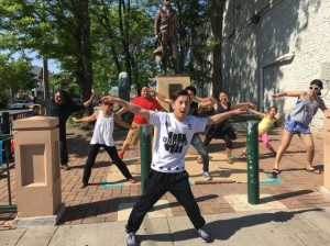 Lue Thao of Cypher Side teaches a breakdance at Cafe con Pan on Lake Street. Submitted photo