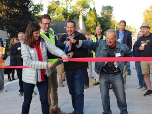 (From left to right): Ward 13 Council Member Linea Palmisano, Minneapolis Chief Field Inspector Kyle Wallace, Rev. John Sommerville of City Church and Morgan Avenue resident Steve Jewell cut a ribbon Sept. 28 to commemorate the reopening of a section of 54th street. Photo by Nate Gotlieb