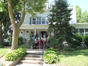 Staff and members gather at Vail Pace, a clubhouse for people with mental illness.