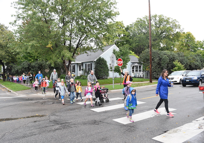 Elementary school students walk to school as part of International Walk and Bike to School Day. File photo