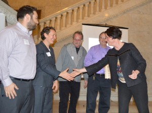 Minneapolis City Council Vice President Elizabeth Glidden (right) shakes hands with Hennepin County Energy Manager Leah Hiniker on Thursday at the Building Energy Challenge awards ceremony. Photo courtesy City of Minneapolis