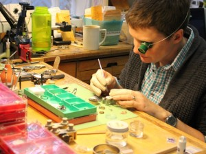 Tyson Niemeyer repairs intricate watches at Caliber Works Watch Repair.