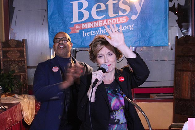 Mayor Betsy Hodges, joined by husband Gary Cunningham, waved to supporters during a brief appearance at her election night party at Gandhi Mahal restaurant. Photo by Dylan Thomas