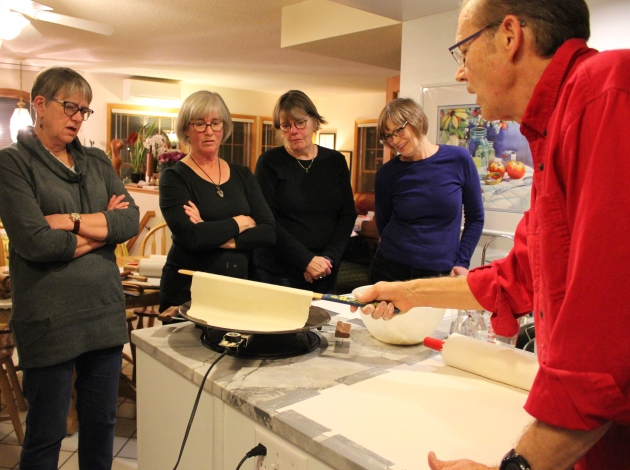 Annette Lynch, Betsy McNulty, Colleen Moriarty and Karin Erickson (l to r) learn to make lefse from Gary Legwold.