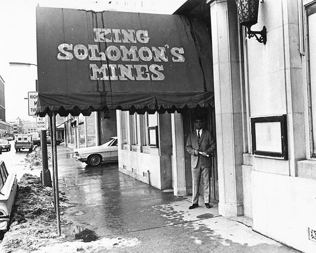 Dean Constantine stands under the awning for King Solomon's Mines, which was located at the base of the Foshay Tower off Ninth Street in downtown Minneapolis. Courtesy of the family of Dean Constantine.