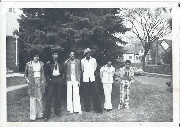 "The historic Grand Central band, featuring (left to right) Linda Anderson, André ""Cymone"" Anderson, Morris Day, Terry Jackson, Prince, and William ""Hollywood"" Doughty, in the front yard of the Anderson home at 1244 Russell Avenue North in Minneapolis. Courtesy of André Cymone."