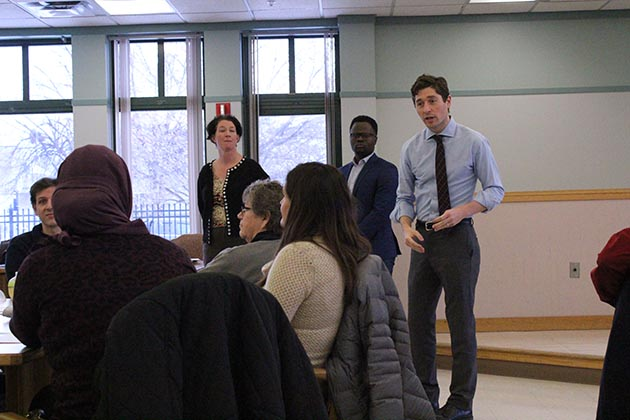 Mayor-elect Jacob Frey, right, held a public listening session Dec. 29 at Horn Towers in the Lyndale neighborhood. He was joined by outgoing City Council Member Elizabeth Glidden and political consultant Abou Amara, two members of his transition team. Photo by Dylan Thomas