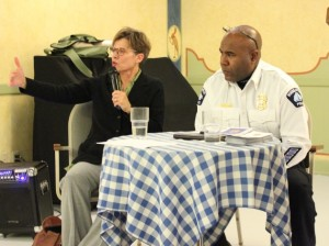 Former Minneapolis Police Department Assistant Chief Kris Arneson and Charlie Adams, commander of the Community and Collaborative Advancement Division, speak at the Black Forest Inn Dec. 5.