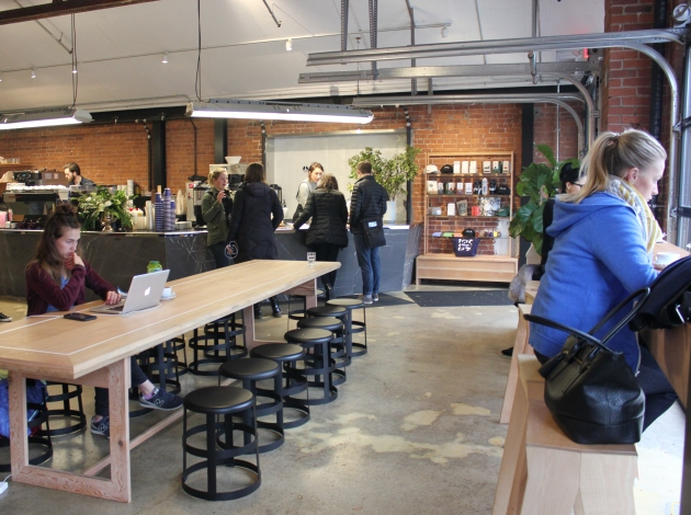 A former auto shop at 44th & Beard now holds co-working spaces, Penny's Coffee, and the BlackBlue boutique in the basement.