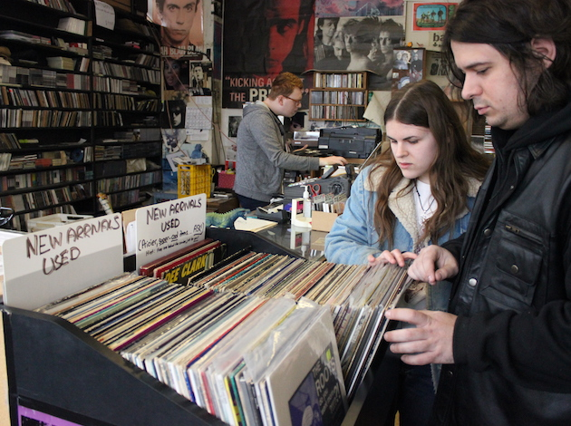 Customers scan the new arrivals in the final days of Treehouse Records.