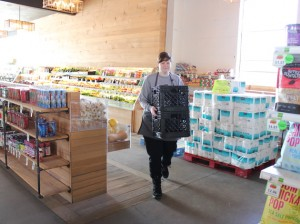 Volunteer Victoria Bobell at Good Grocer, which will build a new store on Nicollet.