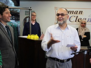 Osman Cleaners owner Arif Osman (right) and Minneapolis Mayor Jacob Frey.