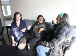 Transitions Manager Kate LaCroix Peal (l) talks with Outreach Specialists Phil Henderson and Alero Ogisi at Rita's House, which opens Feb. 1.