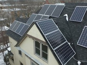 Solar panels line a rooftop in the Lowry Hill East neighborhood. A group of neighbors there are looking to install panels on their homes this year. Submitted photo