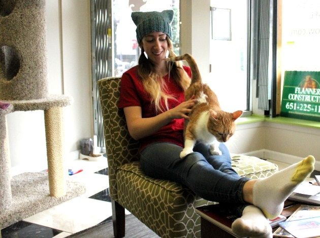 The Café Meow co-founder Jessica Burge relaxes with Nani, a cat up for adoption.