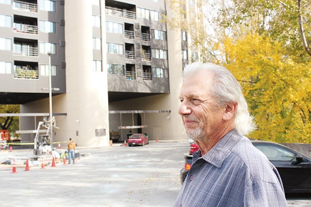 Calhoun-Isles resident Paul Petzschke stands outside the former grain elevator in this 2015 photo. File photo