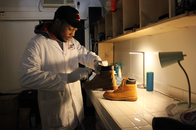 "Maurice ""Mo"" cleans a shoe at Sneaker Clinic."