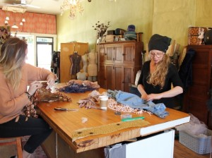 Joy Teiken (right) works at her studio with intern Emily Dufault.