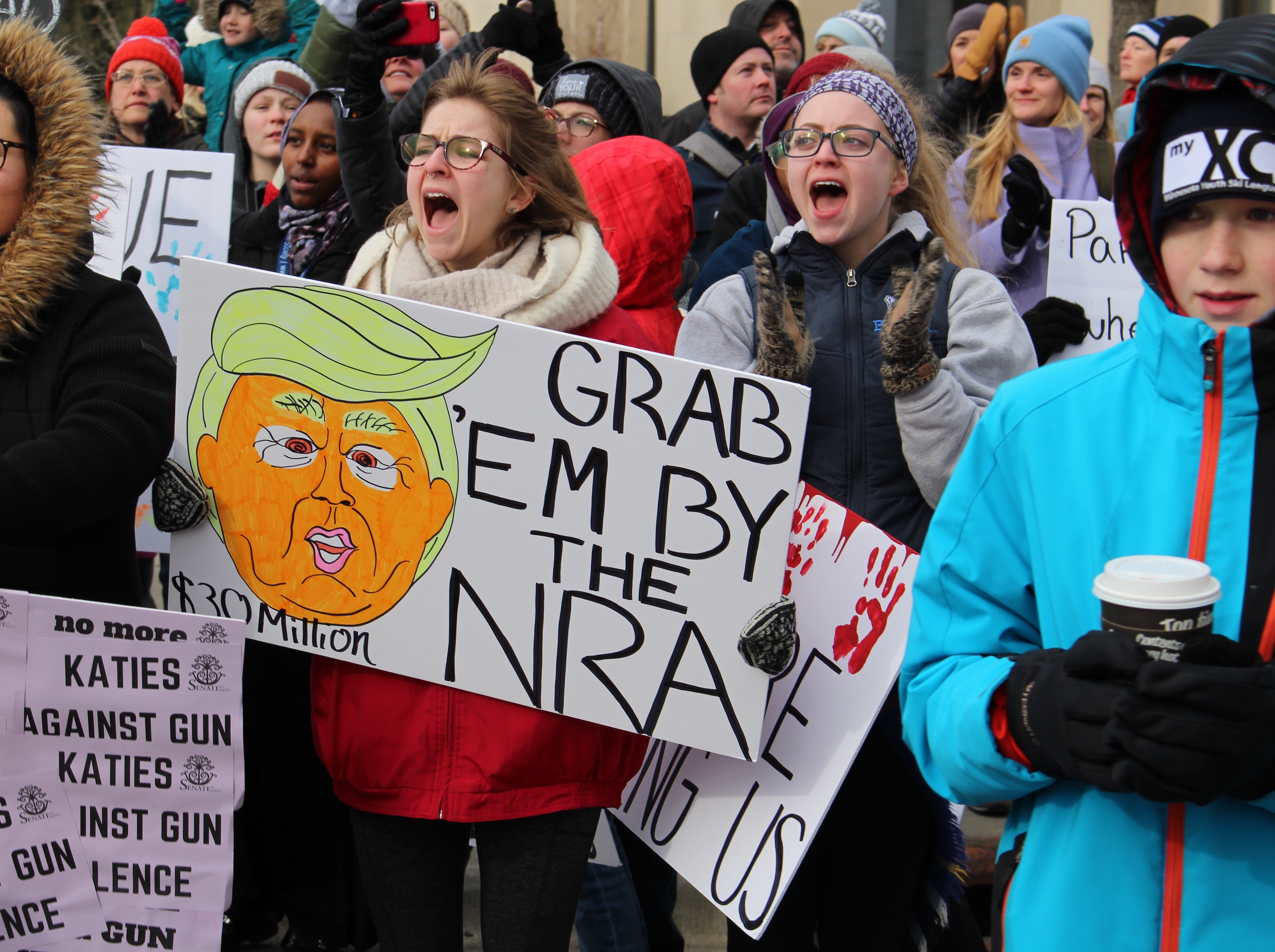 Supporters of the March for Our Lives held signs and cheered Saturday as students marched through downtown St. Paul.