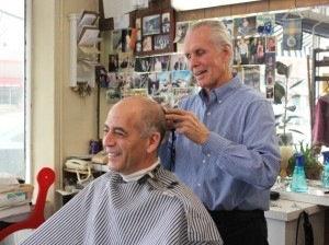 Phil Nelson cuts Dave Ferris's hair at Phil's Barber Shop.