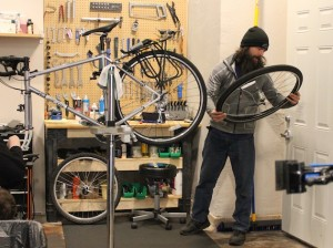 Owner Mike O'Leary works on a bike at the new location.