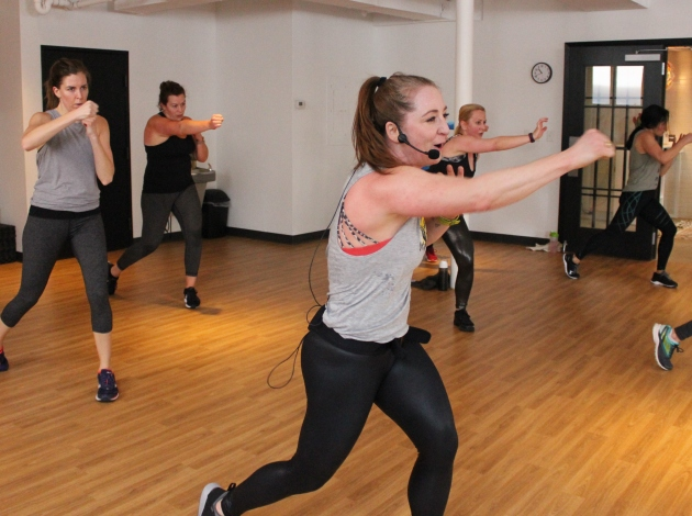 Heather Corndorf teaches a bodyweight cardio and strength class at mXe Movement Studio, now open at 4279 Sheridan Ave. S.