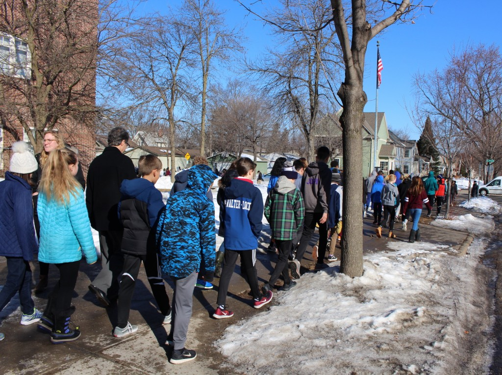 Students walk out of Lake Harriet Upper School on March 14.