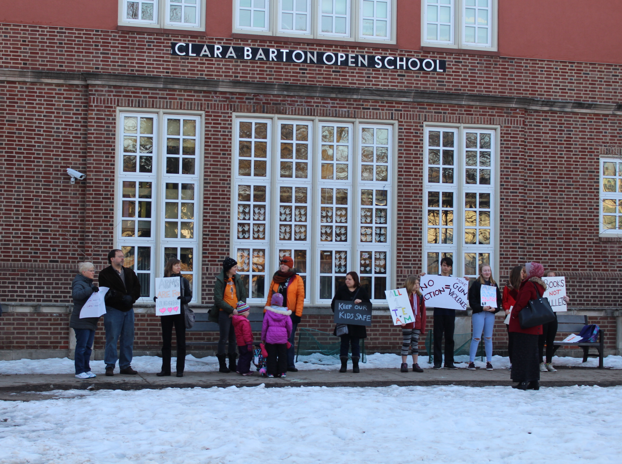 Parents rallied for school safety Friday morning outside of Clara Barton Open School.